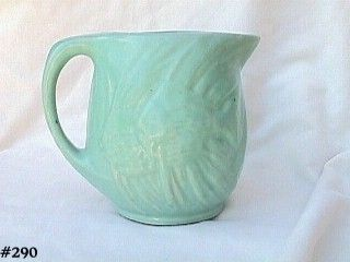 McCOY POTTERY VINTAGE AQUA COLOR PITCHER WITH ANGEL FISH DESIGN