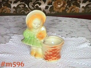 SHAWNEE POTTERY -- LITTLE GIRL WITH BASKET PLANTER