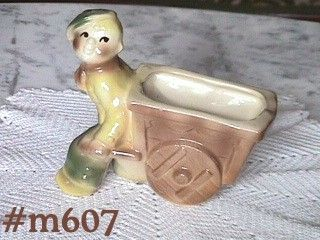 SHAWNEE POTTERY -- BOY PULLING A CART PLANTER