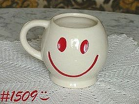 McCOY POTTERY -- WHITE WITH RED SMILEY FACE MUG