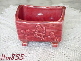 SHAWNEE POTTERY -- BABY CRADLE PLANTER (BURGUNDY COLOR)