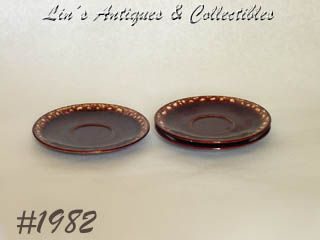 McCOY POTTERY THREE FUTURA BROWN DRIP SAUCERS