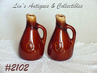 McCOY POTTERY -- VINEGAR AND OIL CRUETS (BROWN DRIP)