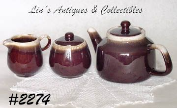 McCOY POTTERY -- BROWN DRIP TEAPOT, CREAMER AND SUGAR