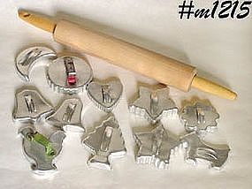 ELEVEN VINTAGE ALUMINUM COOKIE CUTTERS AND A ROLLING PIN!