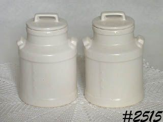 McCOY POTTERY -- TWO WHITE MILK CAN SHAPE CANISTERS