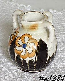 OCCUPIED JAPAN -- SMALL CREAMER WITH 3 HANDLES