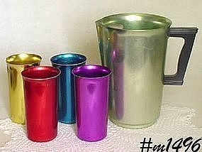 ALUMINUMWARE -- VINTAGE SUNBURST ALUMINUM PITCHER AND 4 TUMBLERS