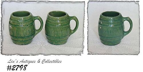McCOY POTTERY -- PAIR OF STONEWARE GREEN BARREL SHAPED MUGS