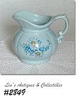 McCOY POTTERY -- BLUE PITCHER WITH BLUE FLORAL DESIGN