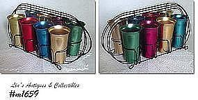 ALUMINUMWARE -- 8 VINTAGE TUMBLERS IN ART DECO STYLE METAL RACK