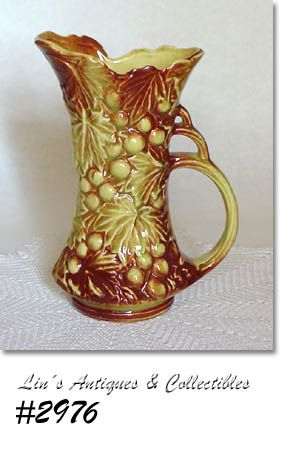 McCOY POTTERY GRAPES AND LEAVES PITCHER VASE YELLOW WITH BROWN ACCENTS