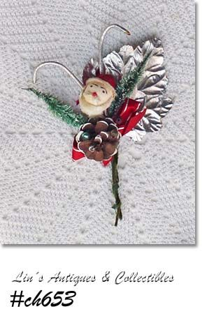 VINTAGE SANTA CHRISTMAS CORSAGE WITH SANTA FACE CANDY CANES AND MORE