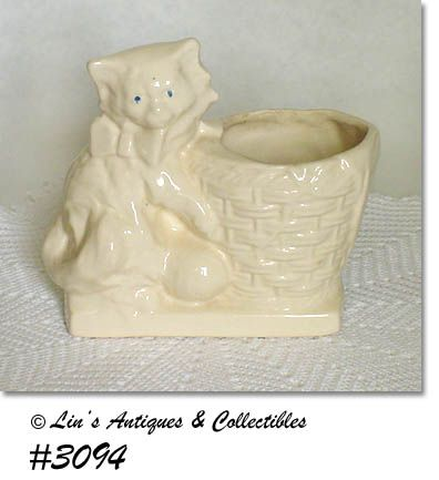 McCOY POTTERY -- KITTEN WITH BASKET PLANTER (WHITE)