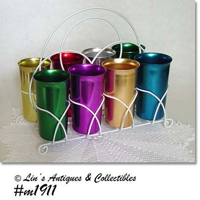 ALUMINUMWARE -- 8 VINTAGE SUNBURST TUMBLERS WITH METAL STORAGE RACK
