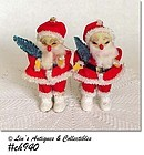 TWO VINTAGE FELT SANTA ORNAMENTS