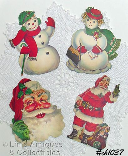CARDBOARD SNOW COUPLE AND TWO SANTAS