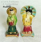 SHAWNEE POTTERY -- GOLD TRIM ORIENTAL BOY AND GIRL FIGURINES
