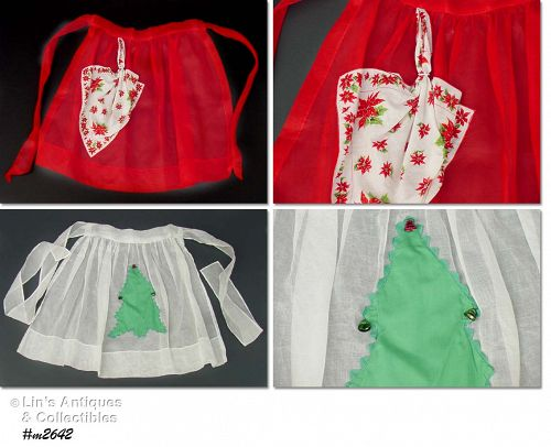 TWO VINTAGE CHRISTMAS APRONS ONE WITH HANKY POCKET ONE WITH BELLS