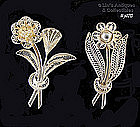 TWO SILVER FLOWER PINS