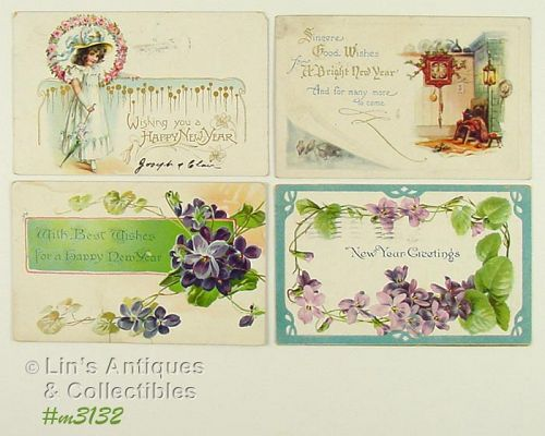 LOT OF FOUR VINTAGE NEW YEAR GREETINGS POSTCARDS 1907 1909 1922