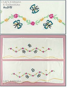 EMBROIDERED FLOWERS AND BUTTERFLIES PILLOWCASES