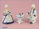 THREE PIECE COLONIAL FIGURINE SET