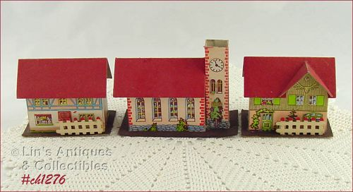 VINTAGE CHRISTMAS TWO CARDBOARD HOUSES AND A CHURCH