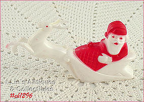 SANTA IN SLED ORNAMENT