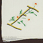 HANKY WITH �E� MONOGRAM AND WHITE DAISIES