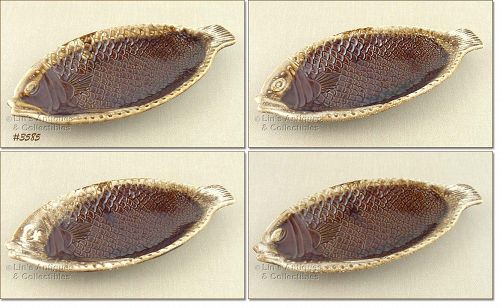 McCOY POTTERY � SET OF FOUR BROWN DRIP FISH PLATES