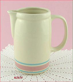 McCOY POTTERY � PINKA ND BLUE PITCHER (7�)
