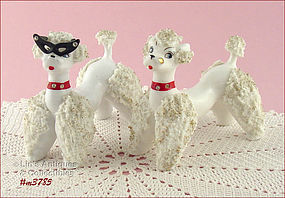 PAIR OF WHITE SPAGHETTI POODLE FIGURINES
