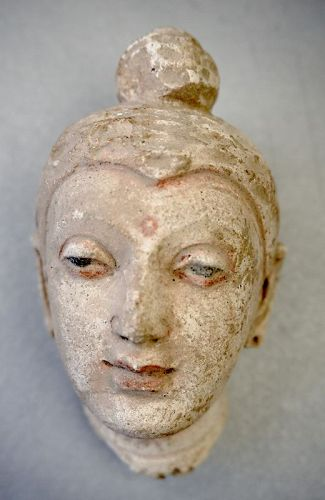 A Gandhara Stucco Head of Buddha with Polychrome Decoration.