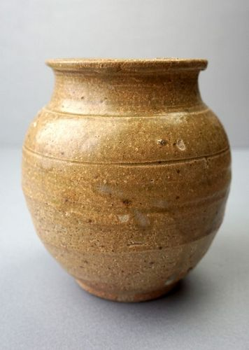 A Tang Dynasty Yue Yao Stoneware Jar with an Olive Green Glaze.