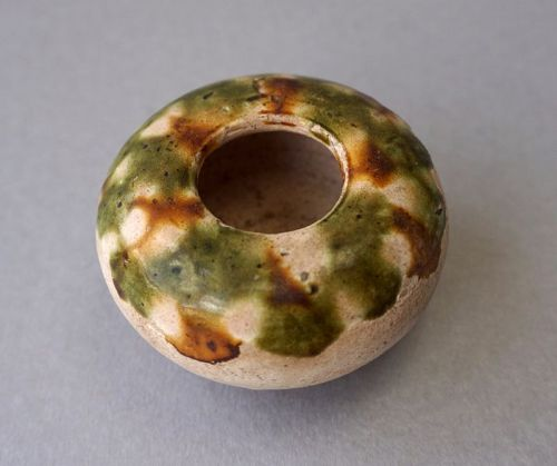 A Tang Dynasty Pottery Water Pot with a Sancai Green and Brown Glaze