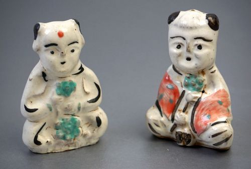 A Pair of Porcelain Toy Figures Holding Ruyi, Yuan Dynasty