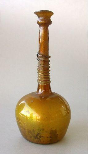 A Fine Islamic Amber Glass Bottle, 9th-13th Century.