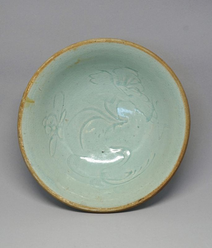 An Early Yuan Qingbai Porcelain Bowl with a Carved Duck& Lotus Plant