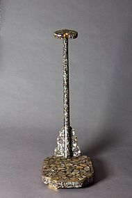 Sword stand with abalone inlay.