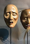 Pair of Noh masks, early 20 th century