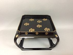 Large lacquered table decorated with Tachibana family crests, Edo