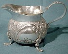 REPOUSSE STERLING SILVER FOOTED CREAMER Sheffield 1900