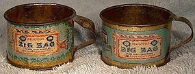 Pair ZIG ZAG CONFECTION TIN LITHOGRAPH PREMIUM MINIATURE CUPS 1900