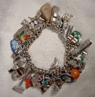 Exceptional Chain Link Sterling Silver Charm Bracelet with 39 Charms