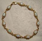10K Yellow Gold Opals Tennis Bracelet with Lots of Colour 1970s
