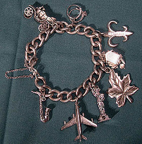 STERLING CHARM BRACELET with 8 CHARMS