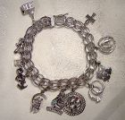 Double Oval Link with Twist Sterling Silver Charm Bracelet 11 Charms