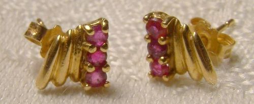 Pair of 14K Yellow Gold Ruby Row Earrings