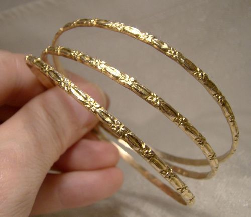 3 10k Yellow Gold Bangle Bracelets with Floral Motif